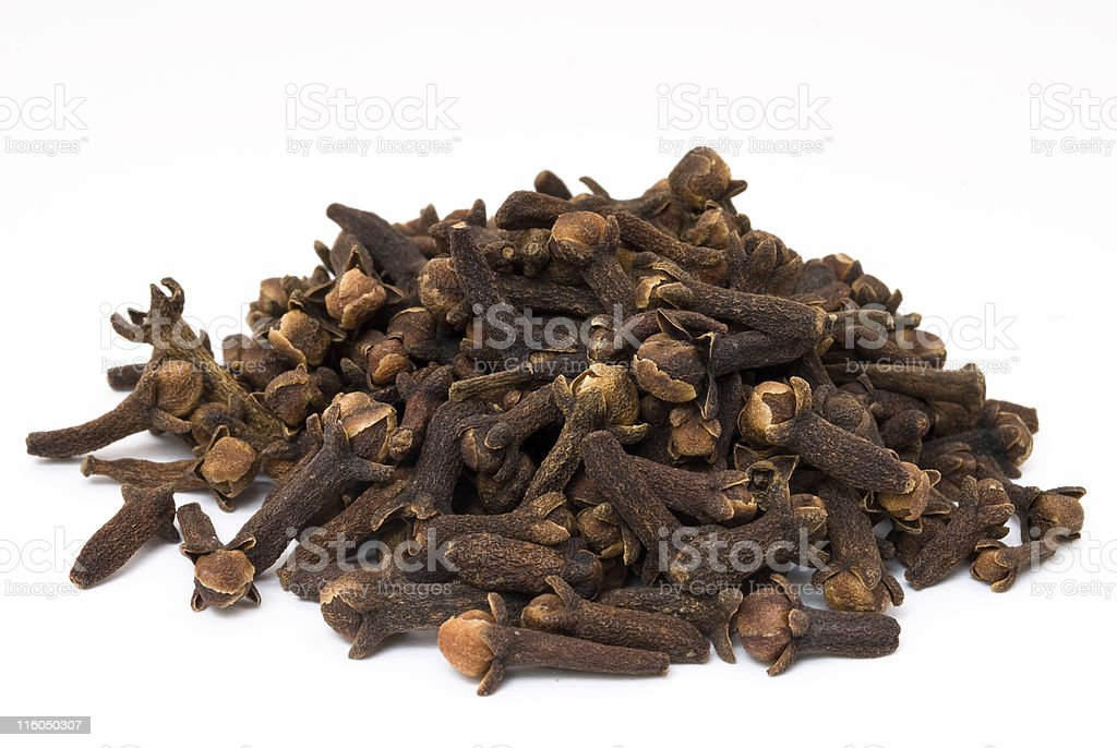 Pile of dried cloves on white royalty-free stock photo
