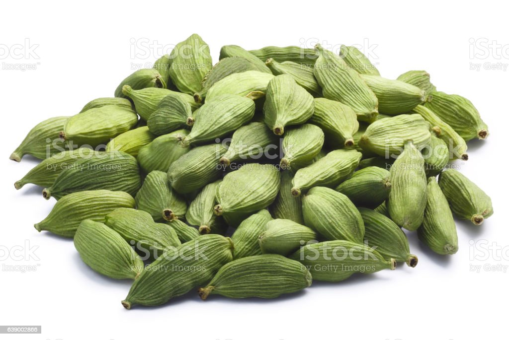 Pile of dried green cardamom pods, paths stock photo