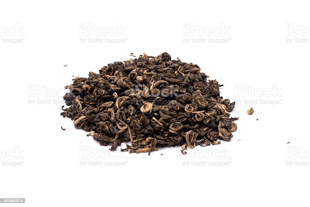 Pile of dried green tea isolated on white background. stock photo