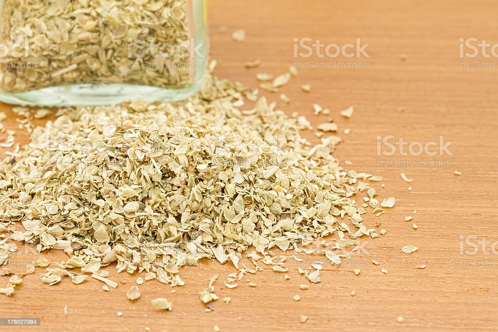 Pile of dried oregano with jar royalty-free stock photo