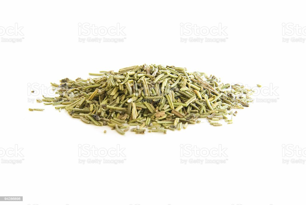 Pile of dried rosemary leaves on white royalty-free stock photo