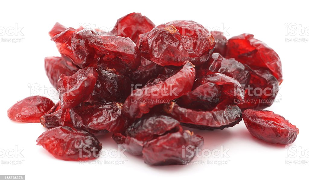 Pile of dried shriveled red cranberries on white background stock photo