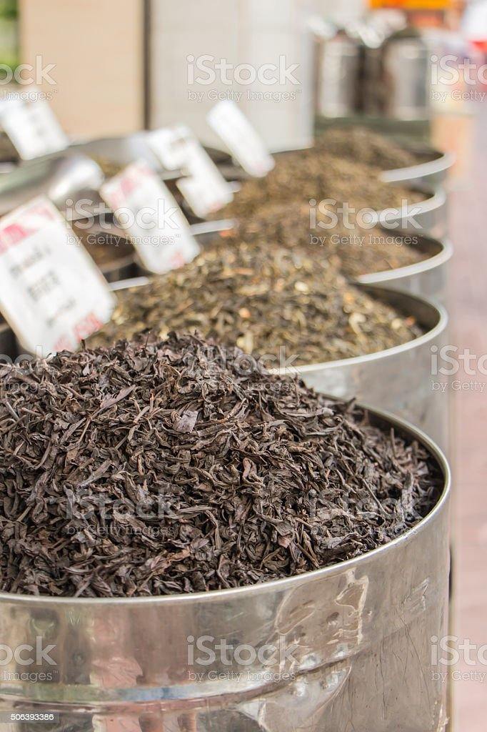 pile of dry tea in tin stock photo