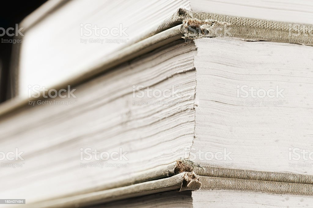 Pile of dusty books with torn leather covers royalty-free stock photo