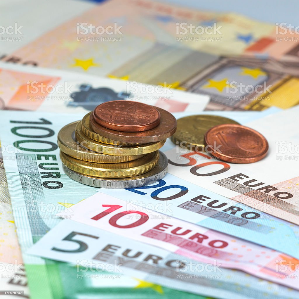 A pile of euro notes and coins royalty-free stock photo