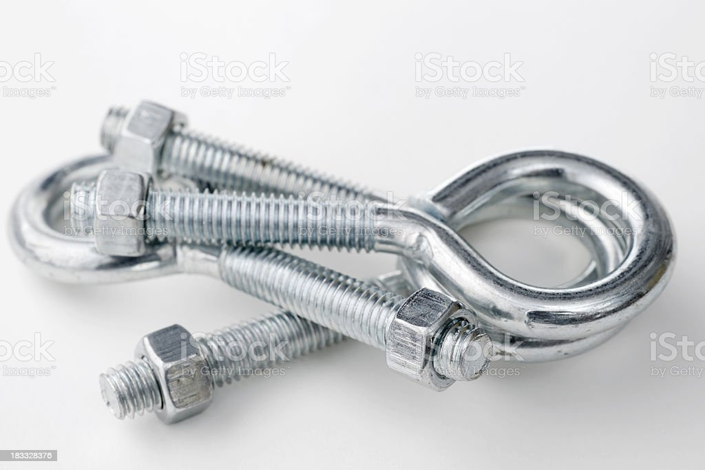 pile of eye bolts with nuts stock photo