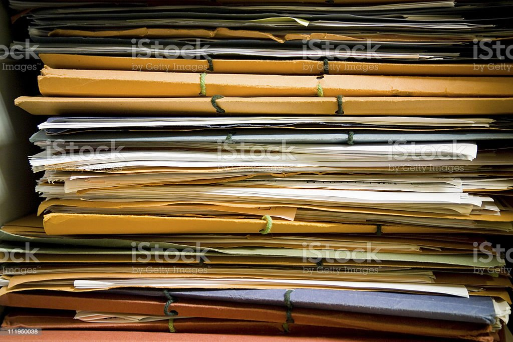 Pile of files in a lawyers office cupboard royalty-free stock photo