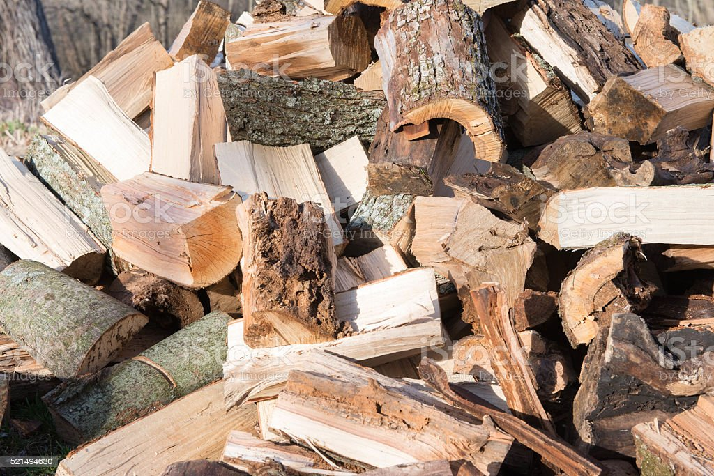 Pile of firewood waiting to be stacked stock photo