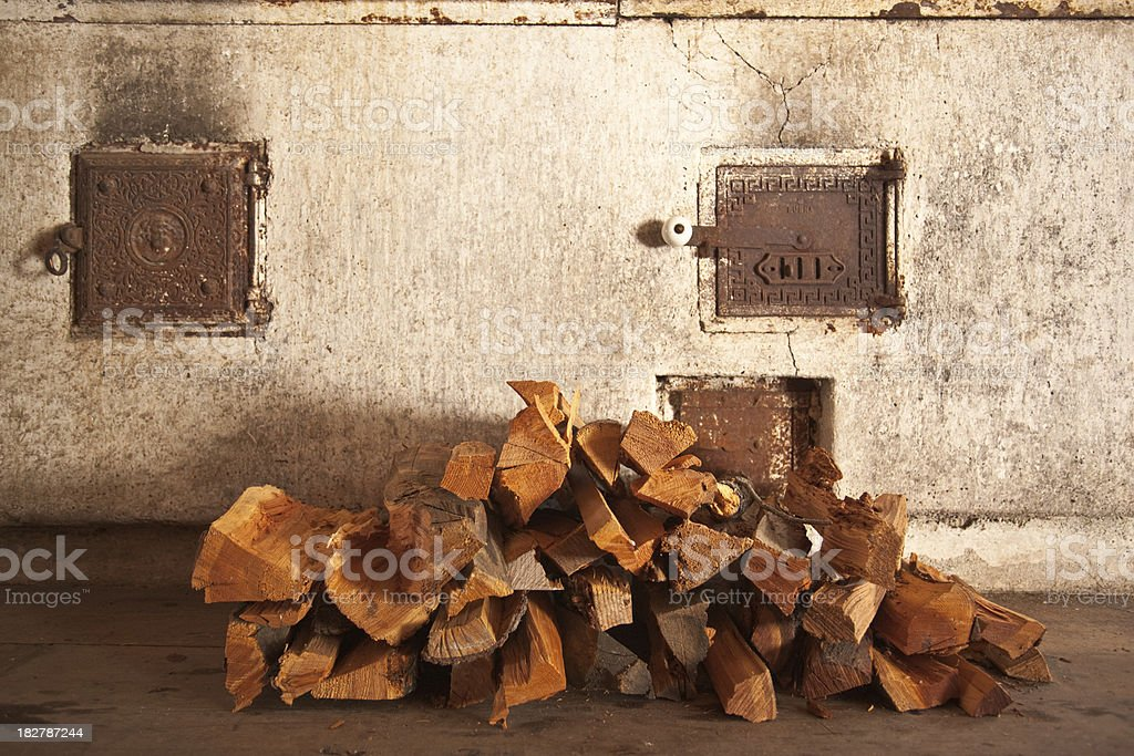 pile of firewood with old oven royalty-free stock photo