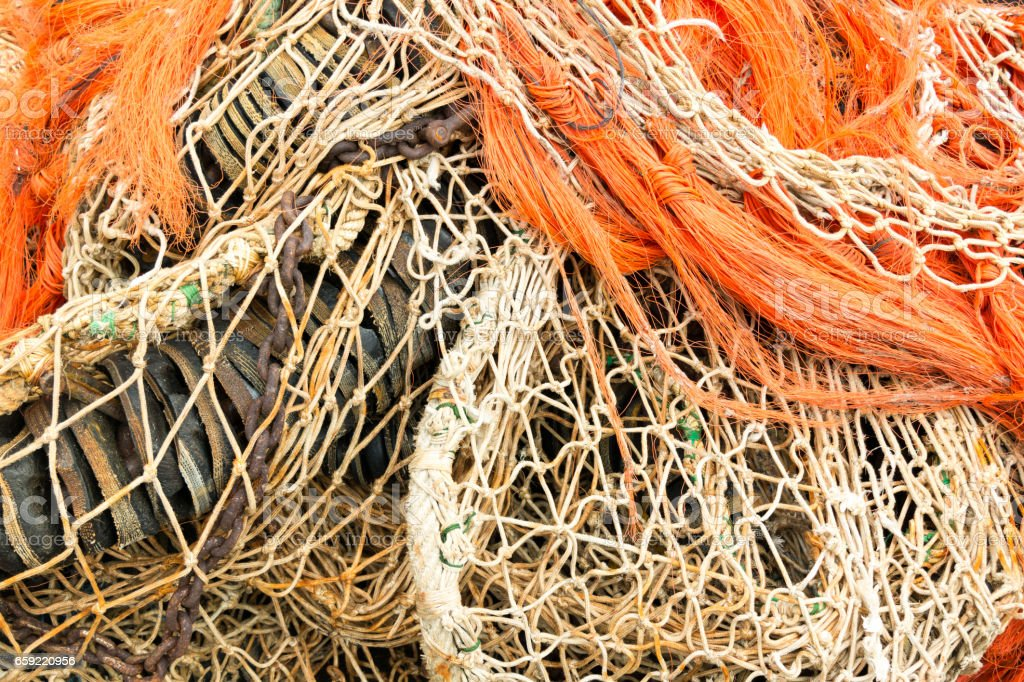 Pile of fishing nets and rope stock photo