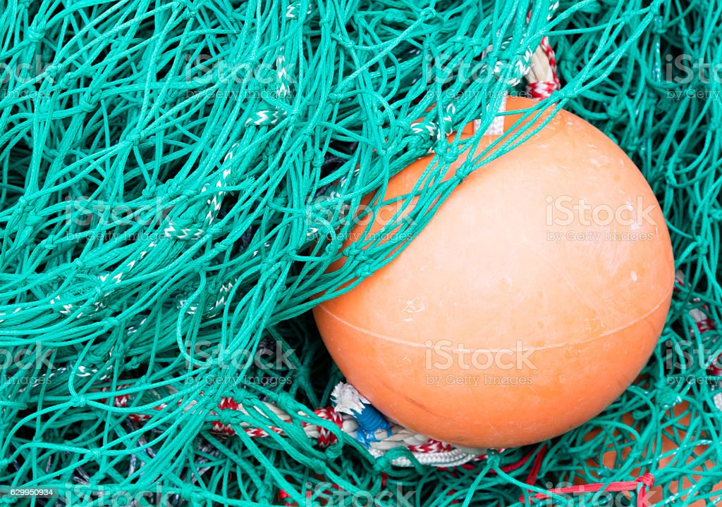 Pile of fishing nets stock photo