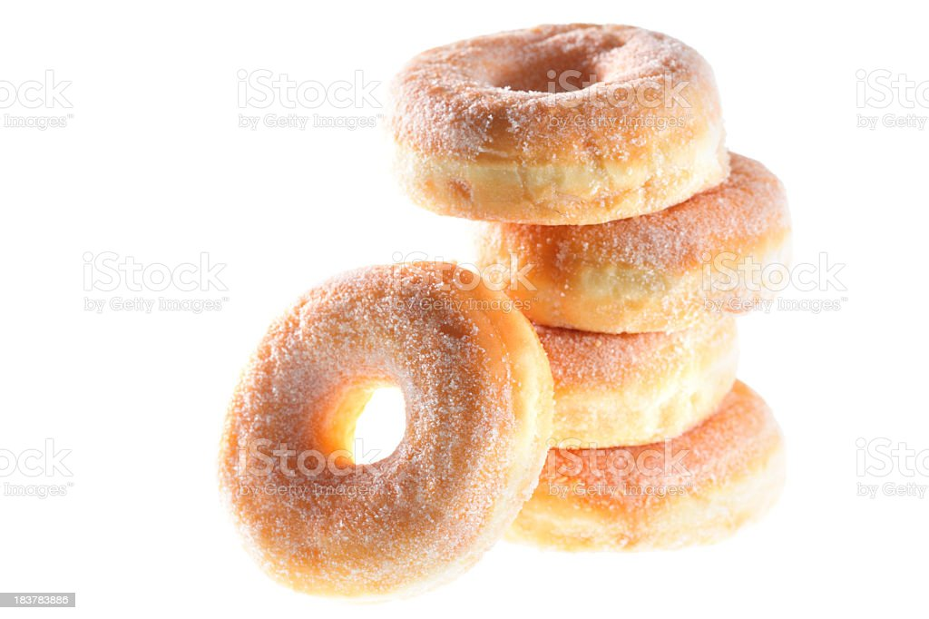 Pile of five sugared donuts backlit with white background royalty-free stock photo