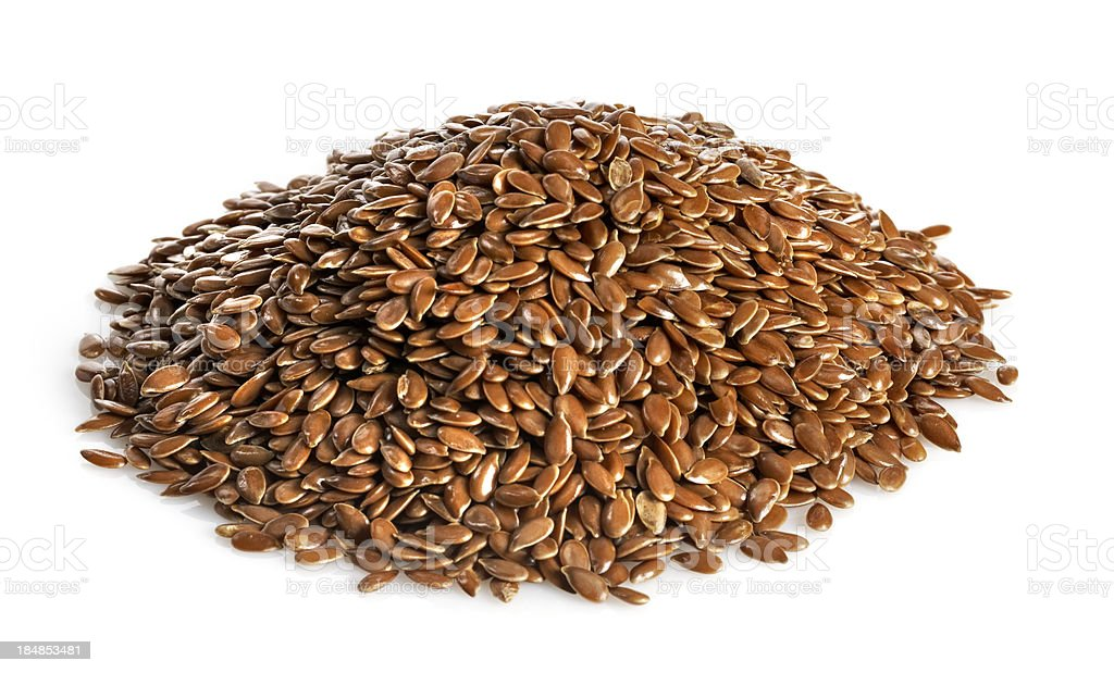 Pile of flax seed isolated on white stock photo