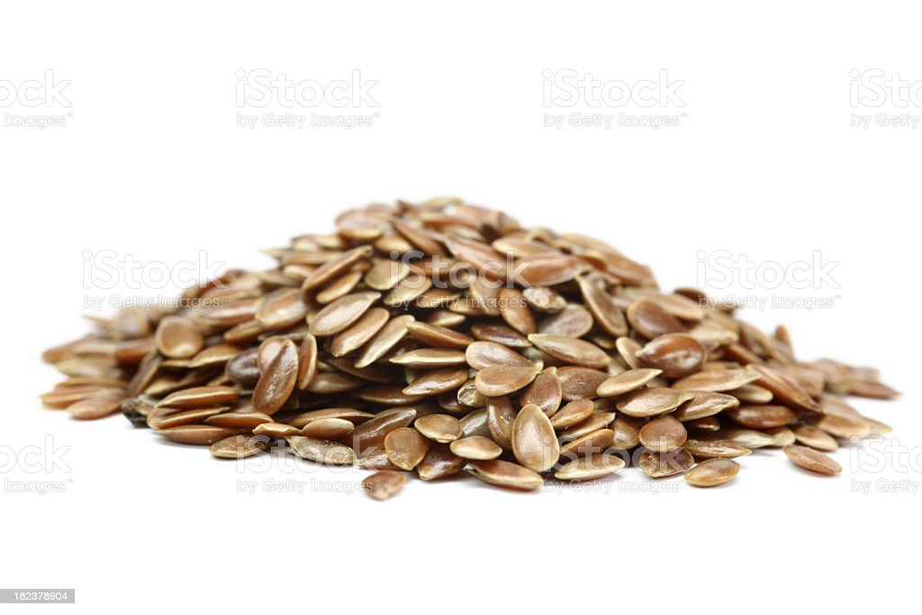A pile of flaxseed isolated on white stock photo