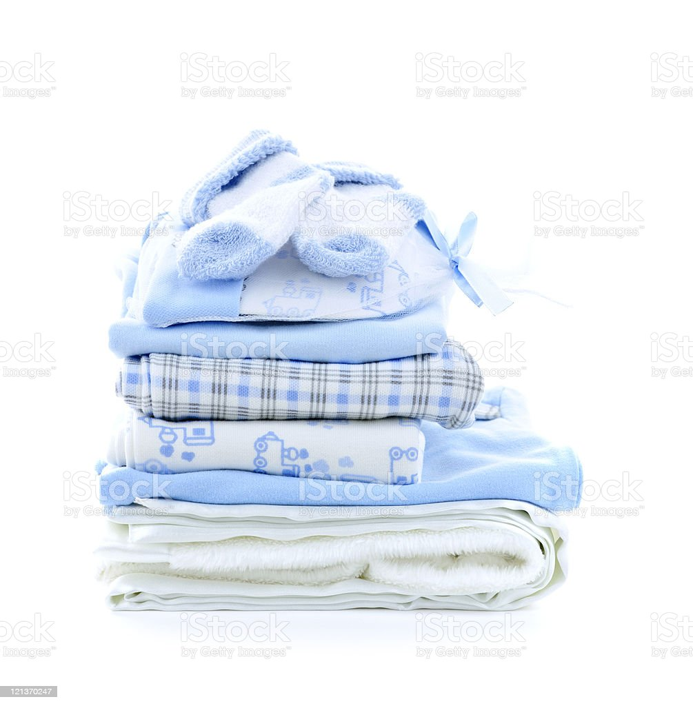 Pile of folded blue and white baby clothes stock photo
