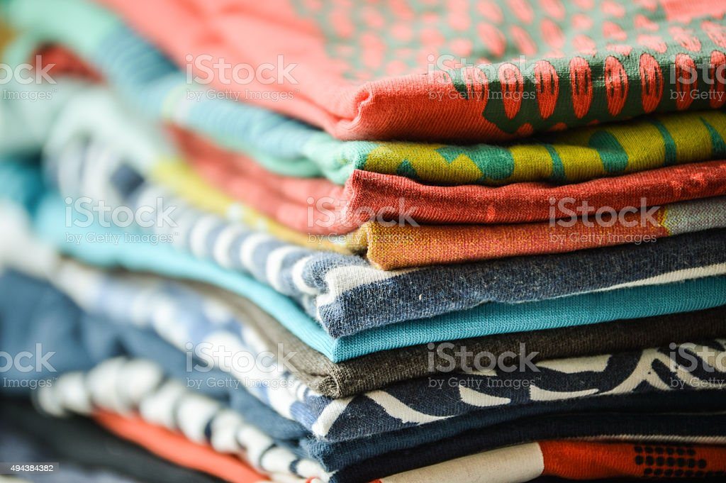 Pile of folded clothes stock photo
