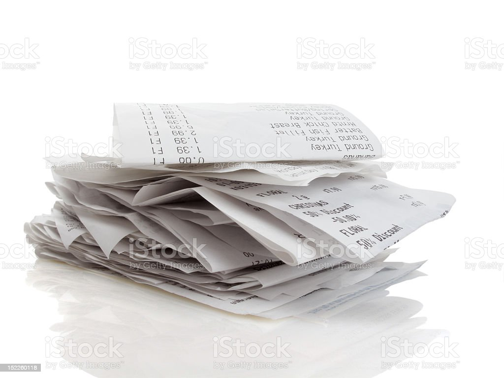 Pile of folded merchant receipts on white background stock photo