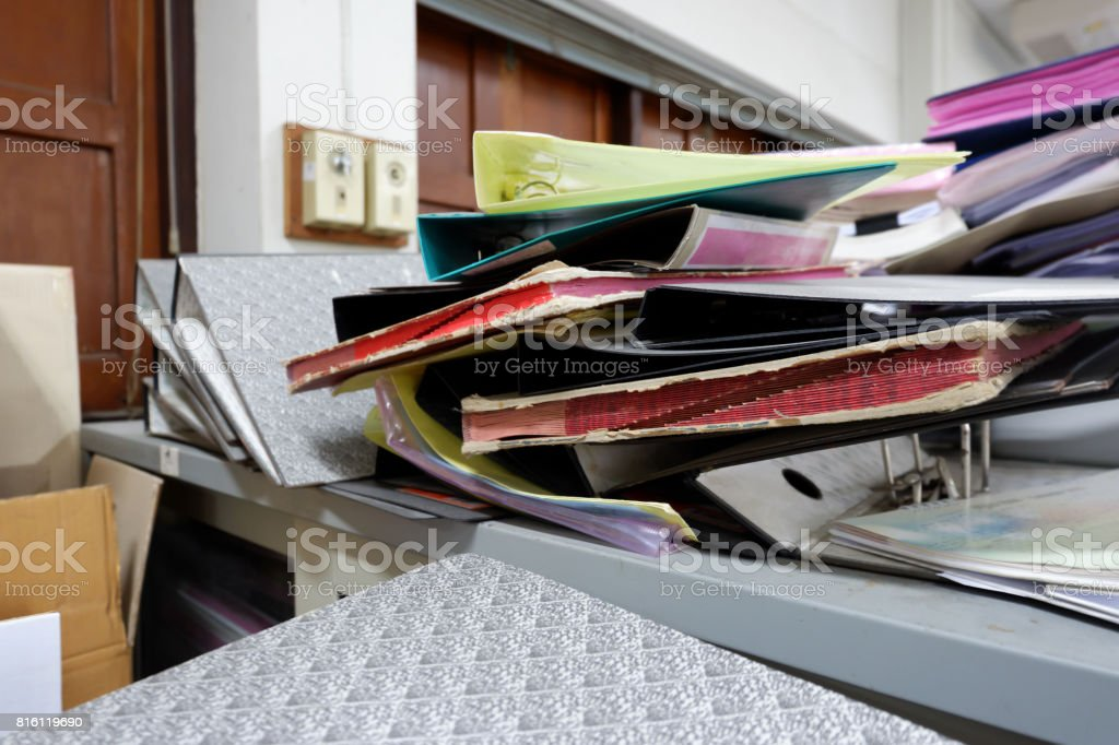 Pile of folder on cabinet at workplace stock photo