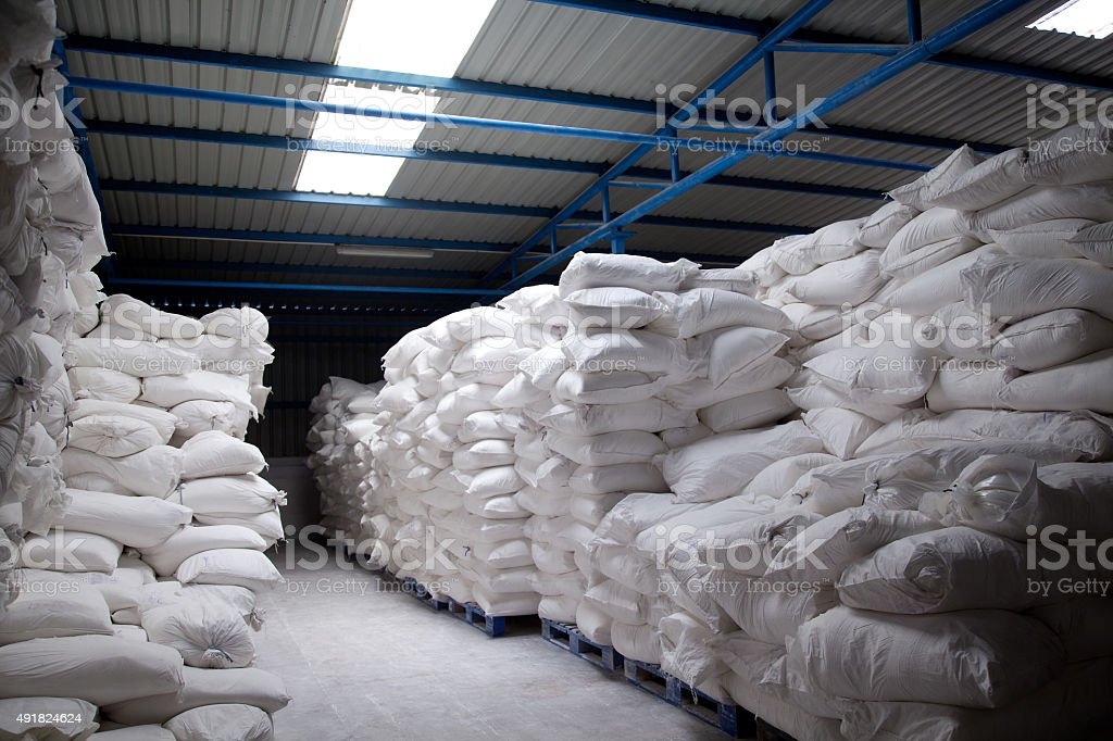 Pile of food sacks stored in warehouse. stock photo