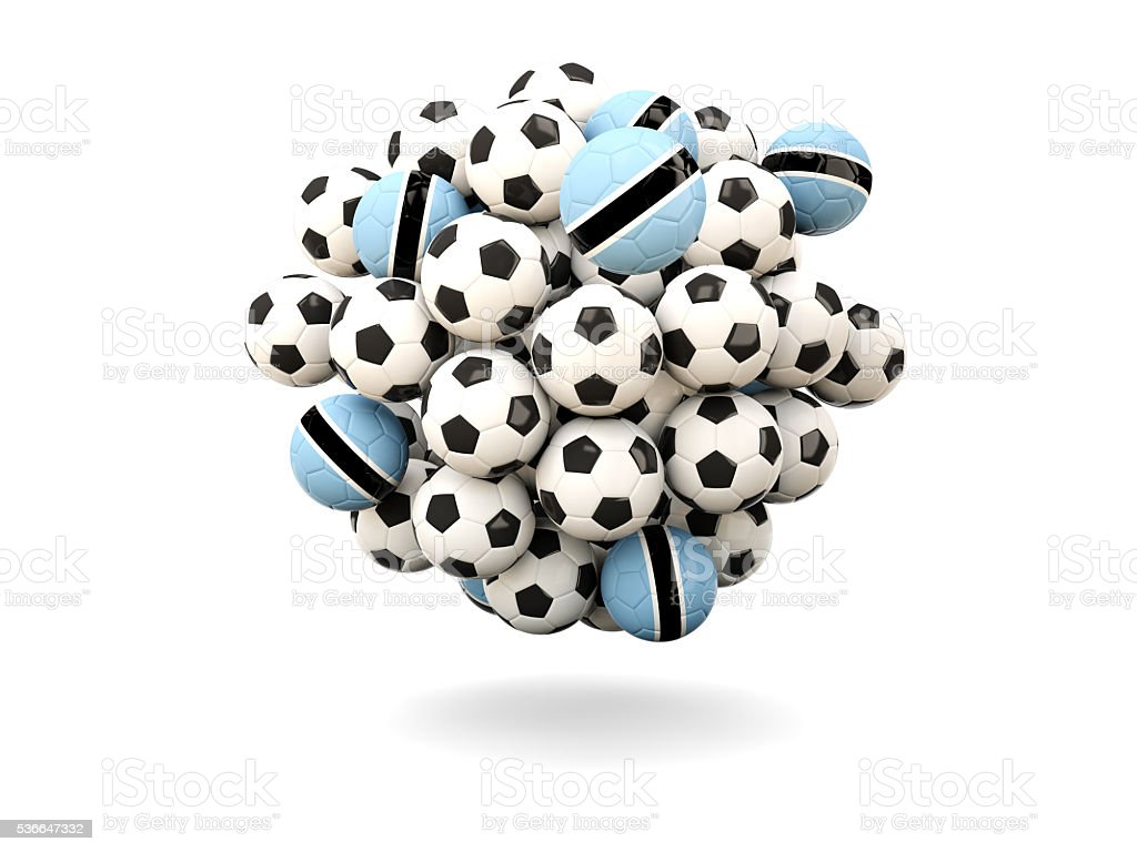 Pile of footballs with flag of botswana stock photo