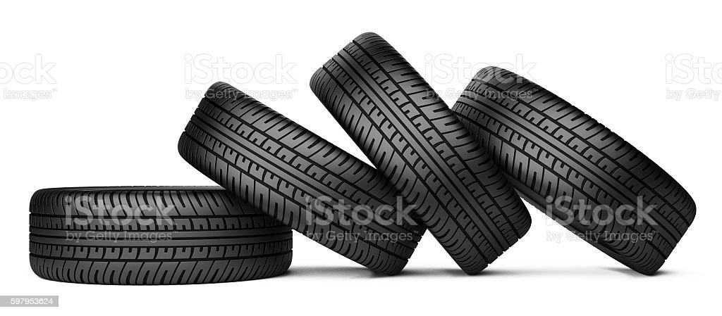 Pile of four black wheel tyres for car stock photo