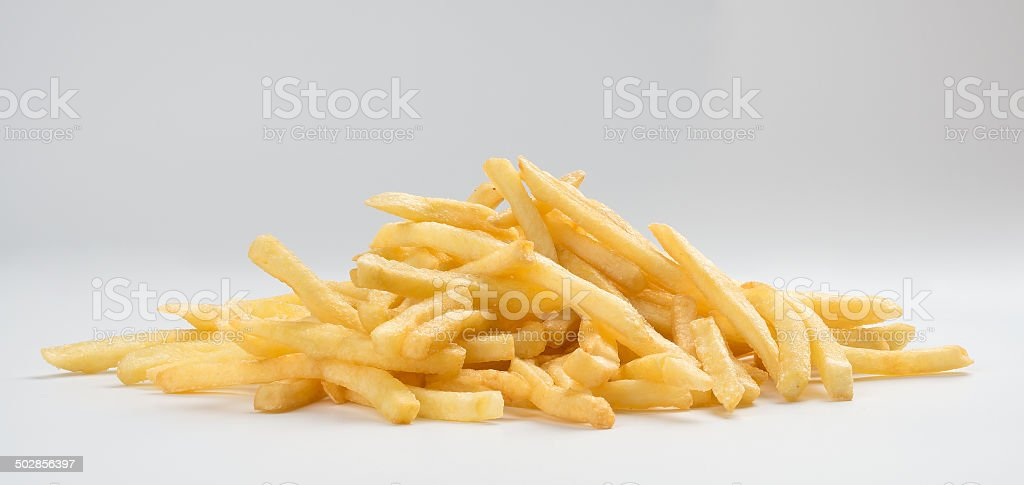 pile of french fries stock photo