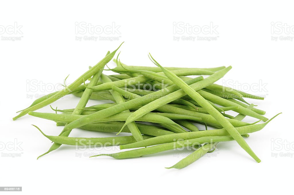 A pile of French green beans on white background royalty-free stock photo