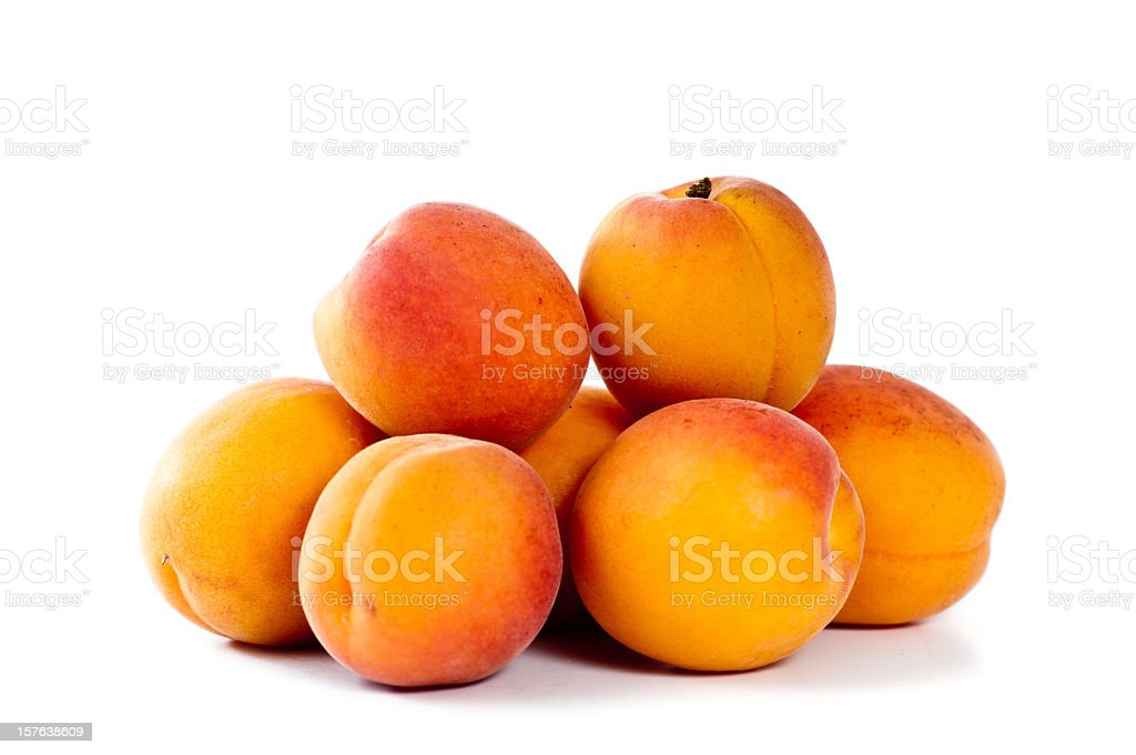 A pile of fresh apricots on a white background stock photo
