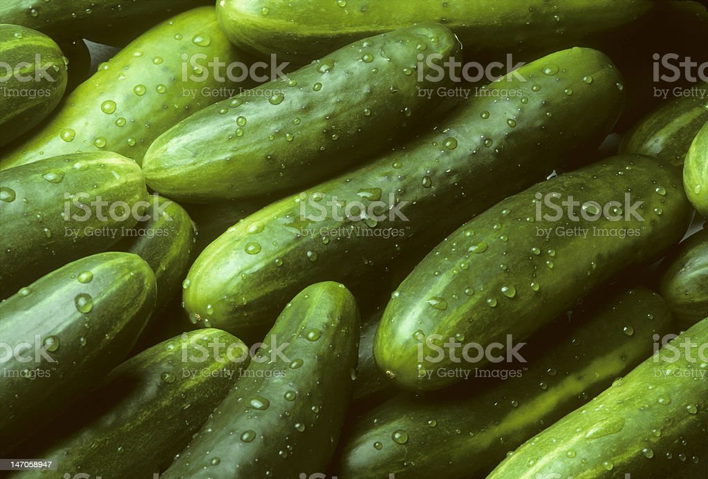 Pile of fresh cucumbers lying diagonally stock photo