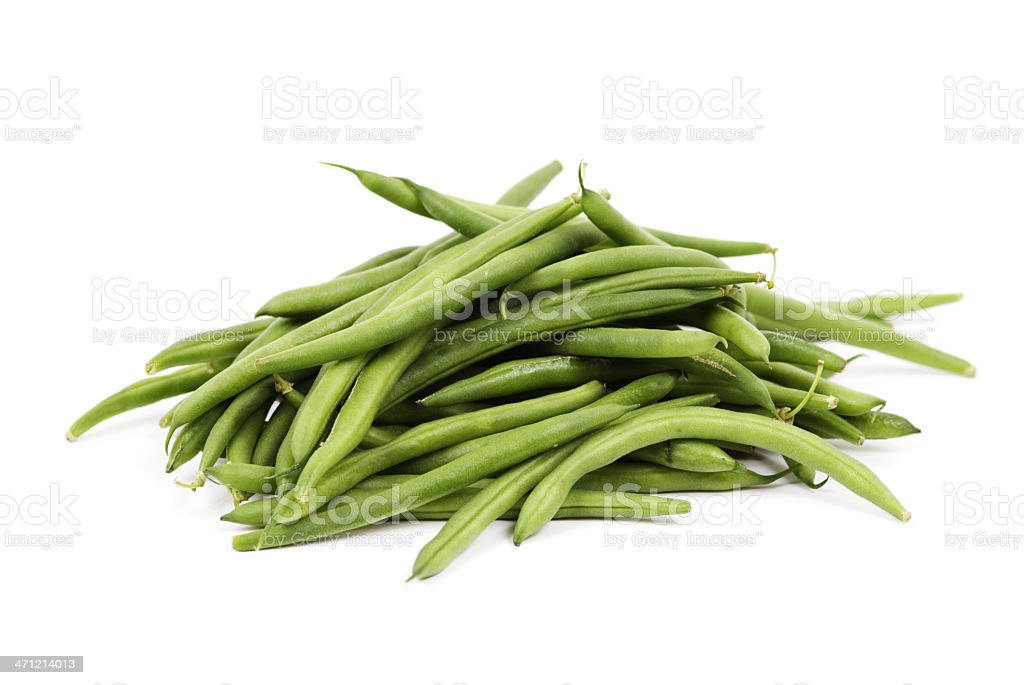 Pile of fresh green beans over a white background stock photo