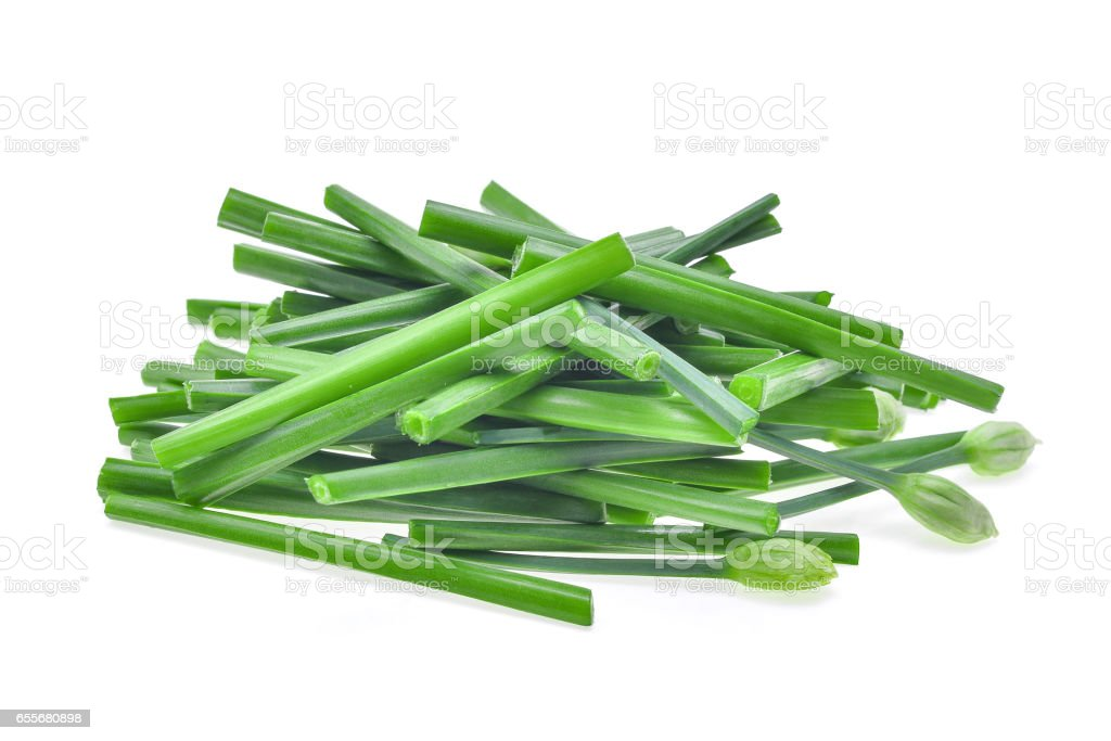 pile of fresh slice green chinese chives isolated on white background stock photo