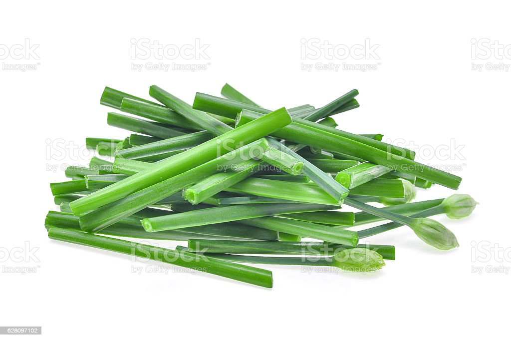 pile of fresh slice green chinese chives isolated on white stock photo