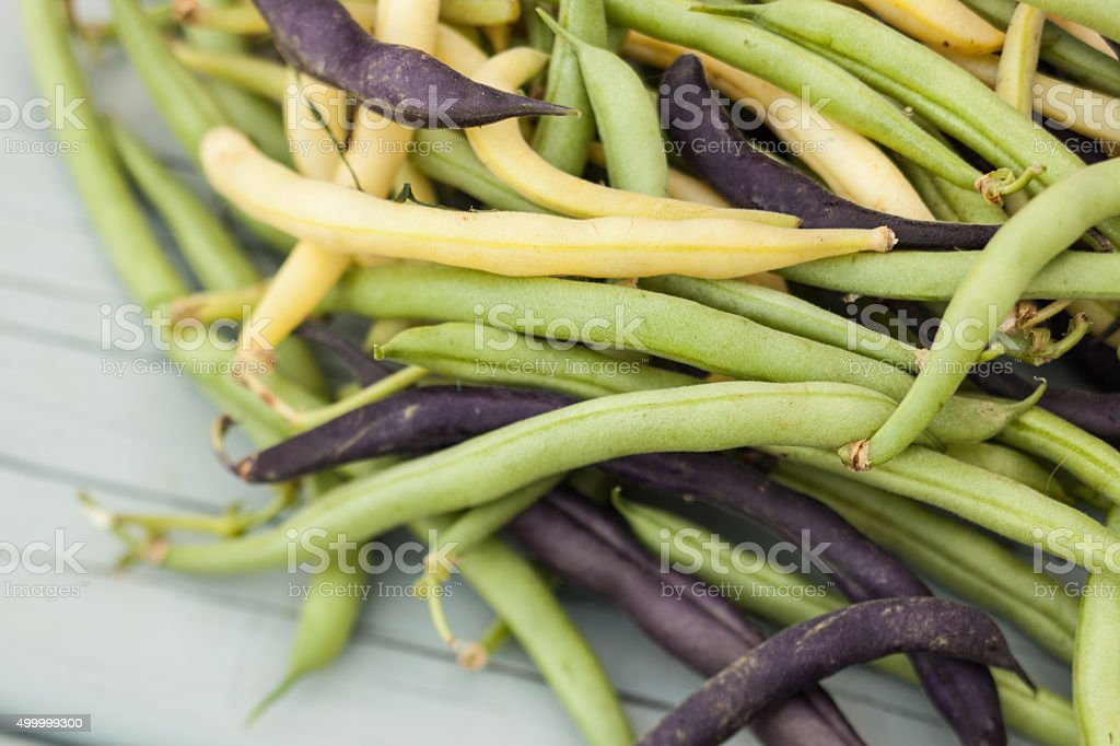 Pile of fresh string beans on wood table stock photo