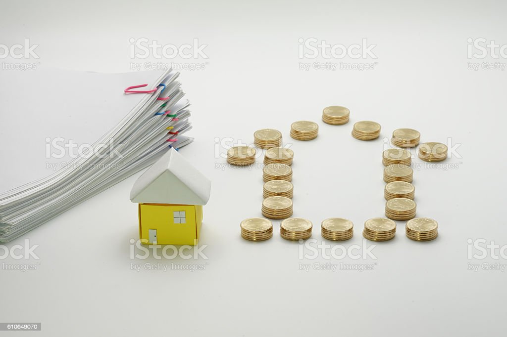 Pile of gold coins and house with pile overload document royalty-free stock photo