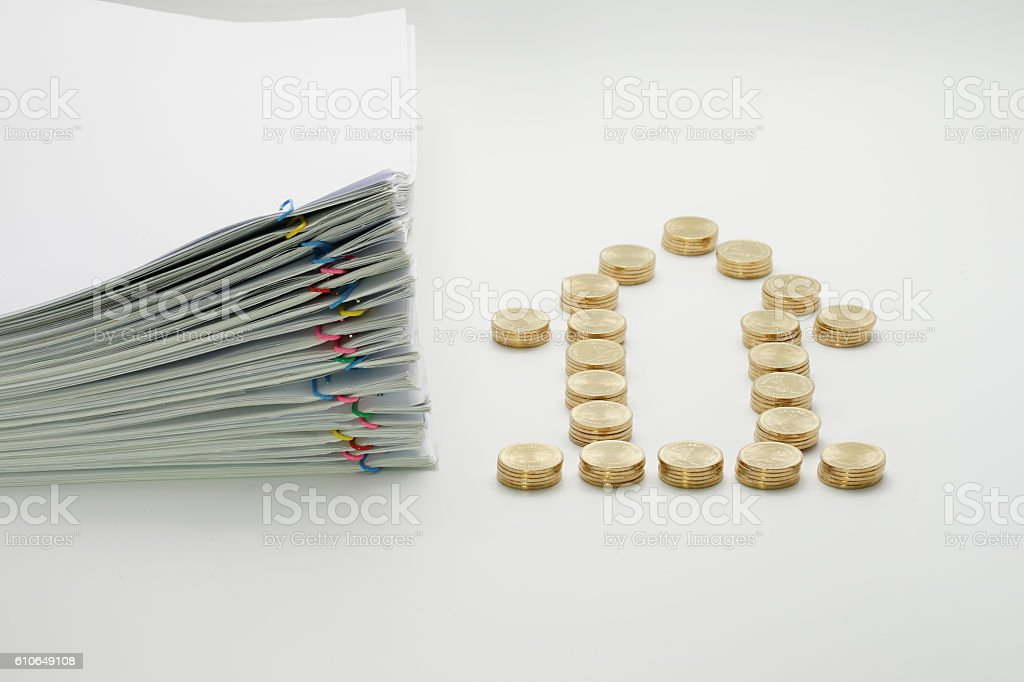 Pile of gold coins and pile overload paperwork royalty-free stock photo
