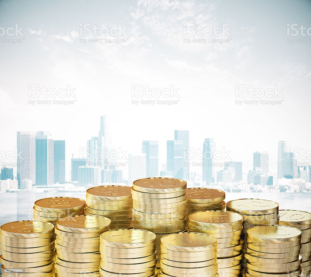Pile of gold coins at city background stock photo