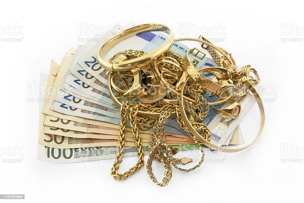 Pile of Gold Jewelery with Euro Notes stock photo