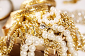 Pile of gold jewelry and pearls