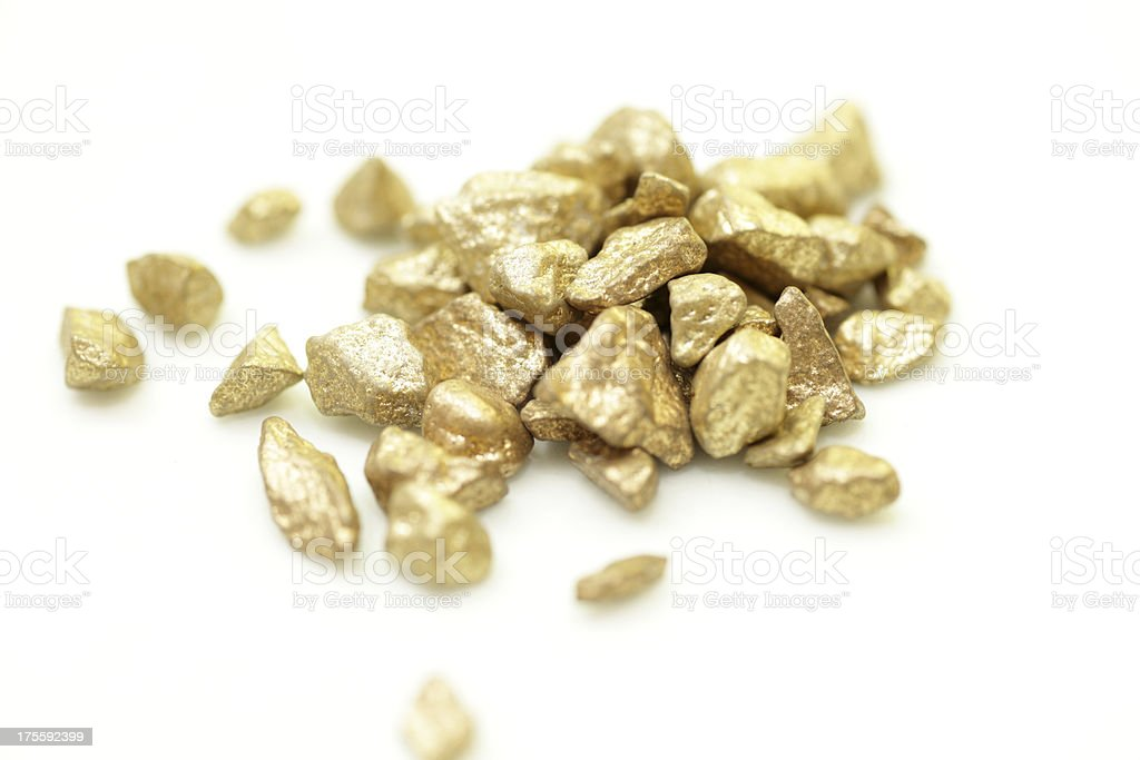 Pile of gold nuggets isolated on white stock photo