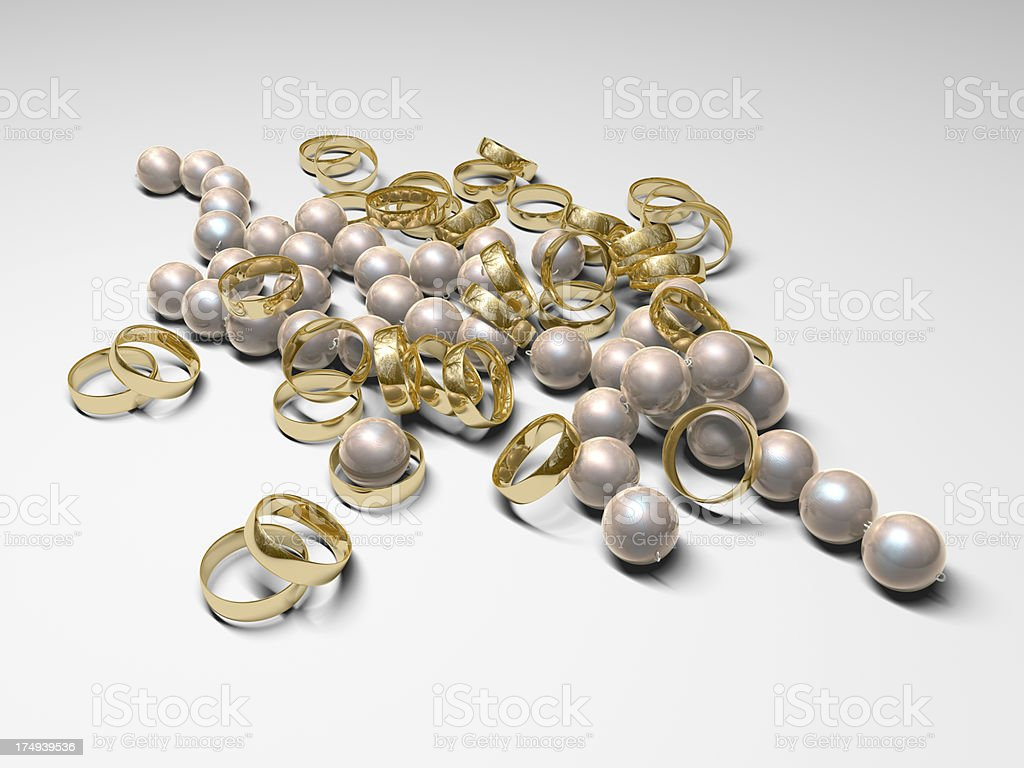Pile of Gold Wedding Rings and Pearls royalty-free stock photo