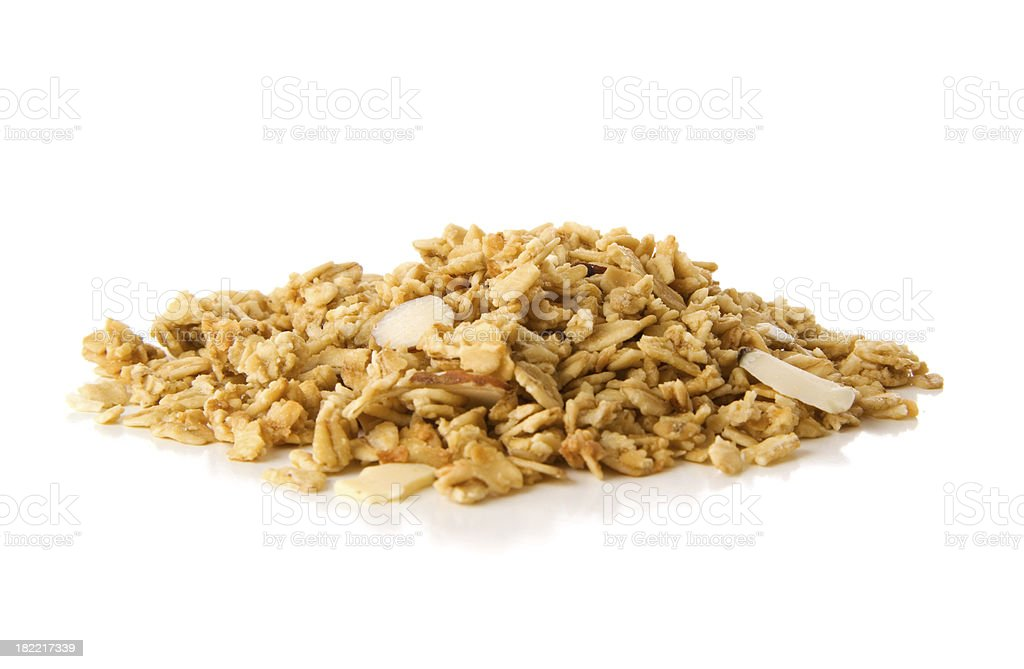 Pile of granola cereal with almonds on white stock photo