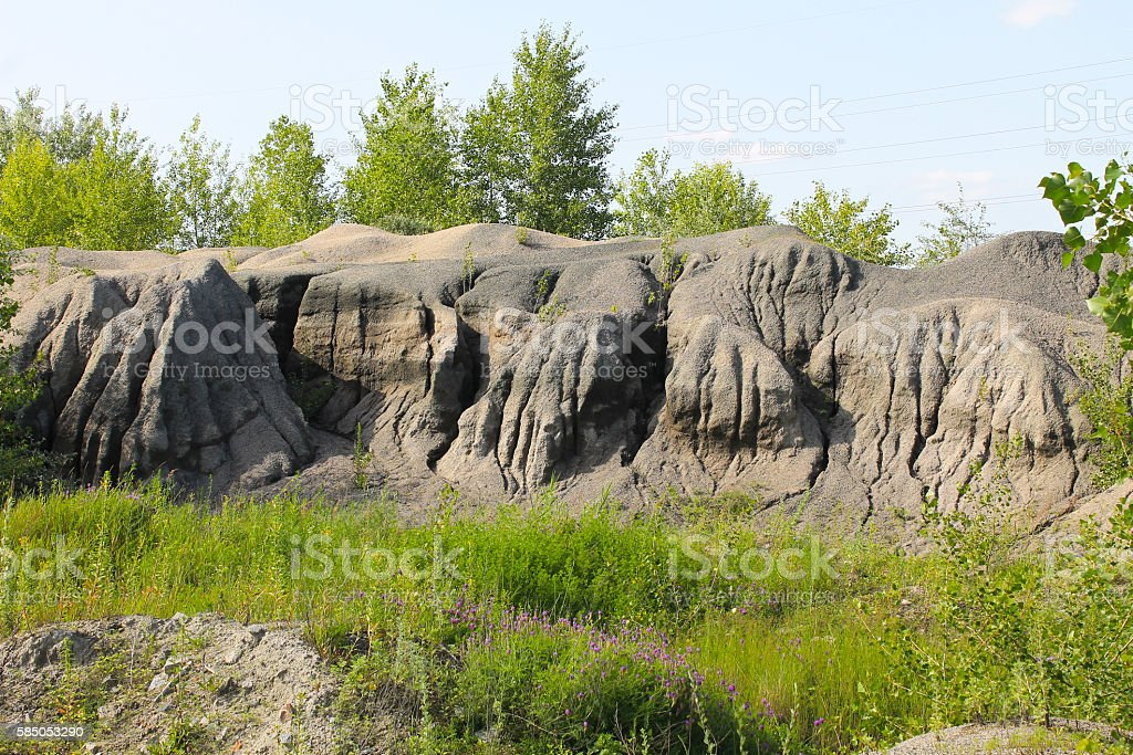 Pile of gravel with water stains from rain stock photo