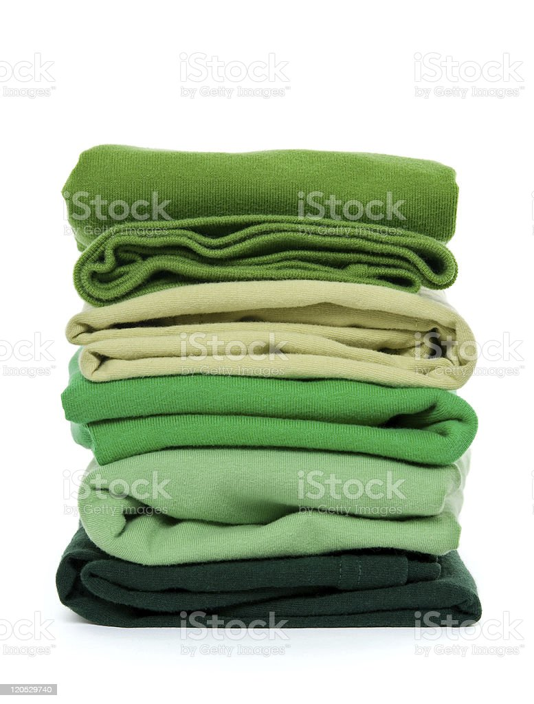 Pile of green folded clothes stock photo