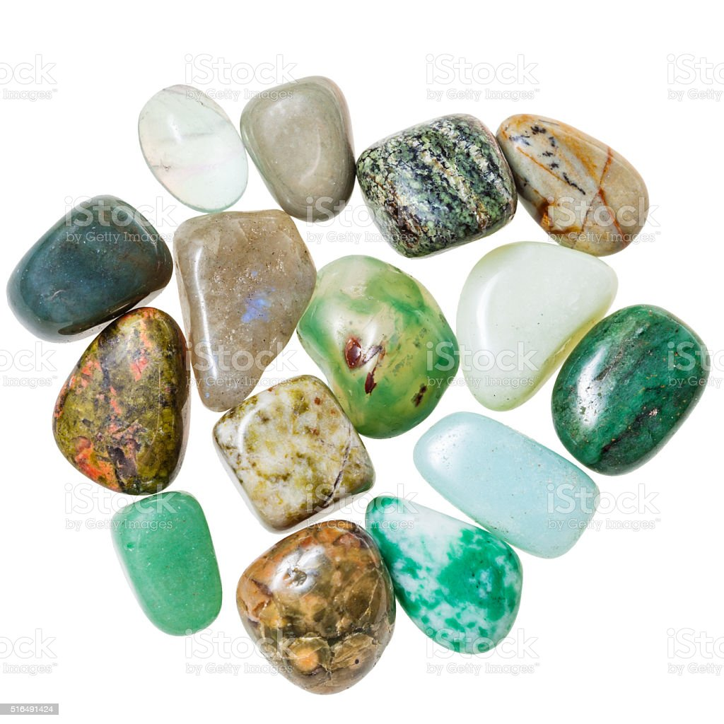 pile of green natural mineral gemstones isolated stock photo