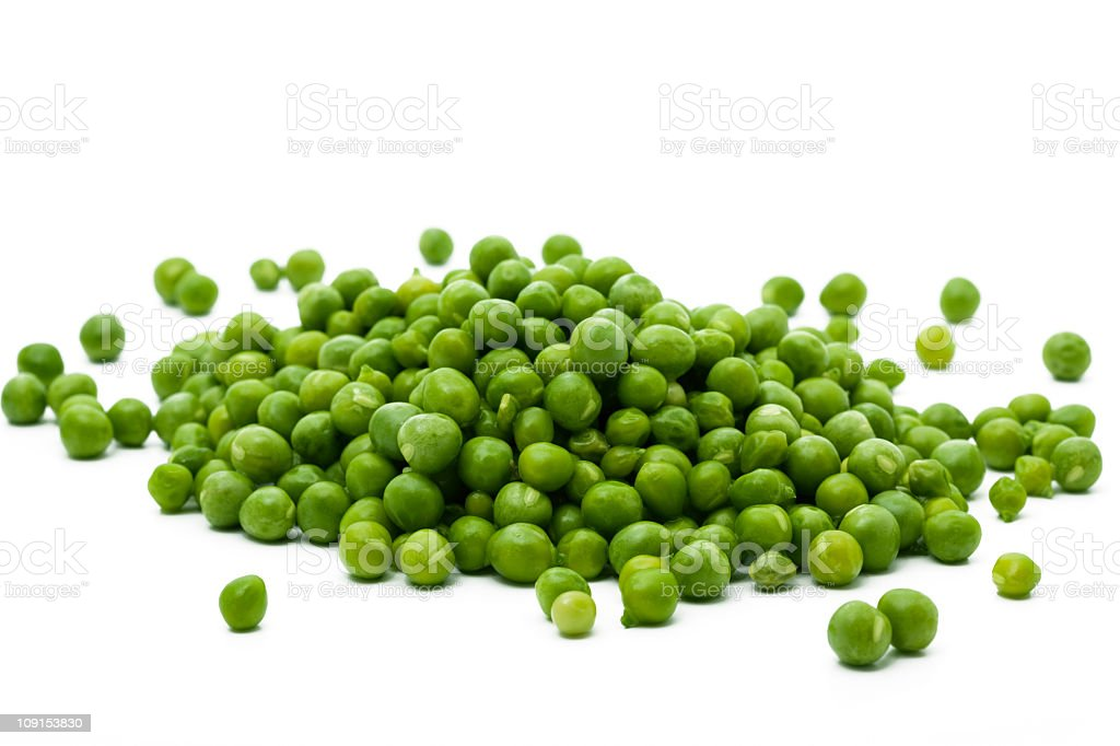pile of green peas stock photo