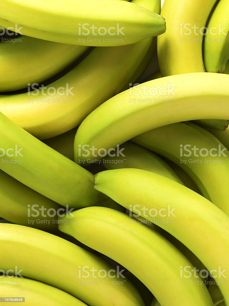 Pile of green tinted bananas in close-up stock photo