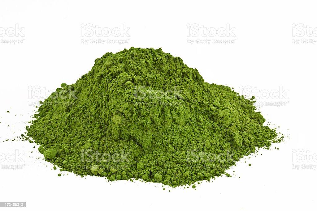 Pile of green wheatgrass powder stock photo