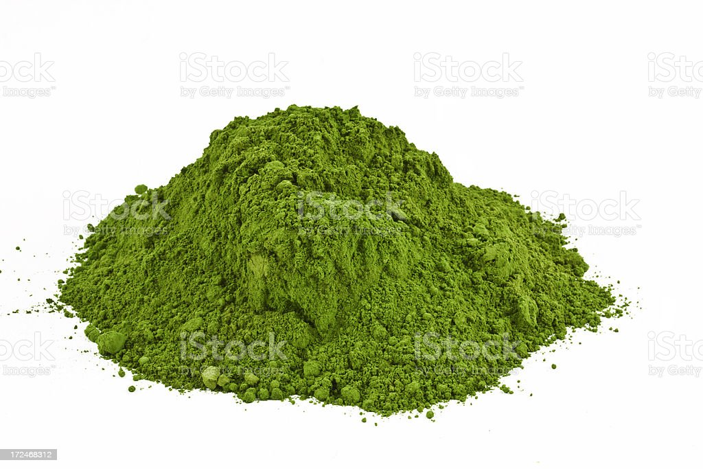Pile of green wheatgrass powder stock photo