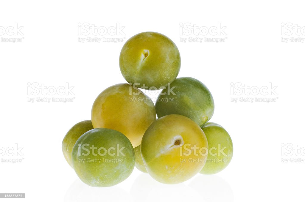 Pile Of Greengages Isolated Against White. stock photo