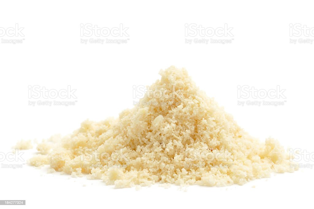 A pile of ground almond on a white background stock photo